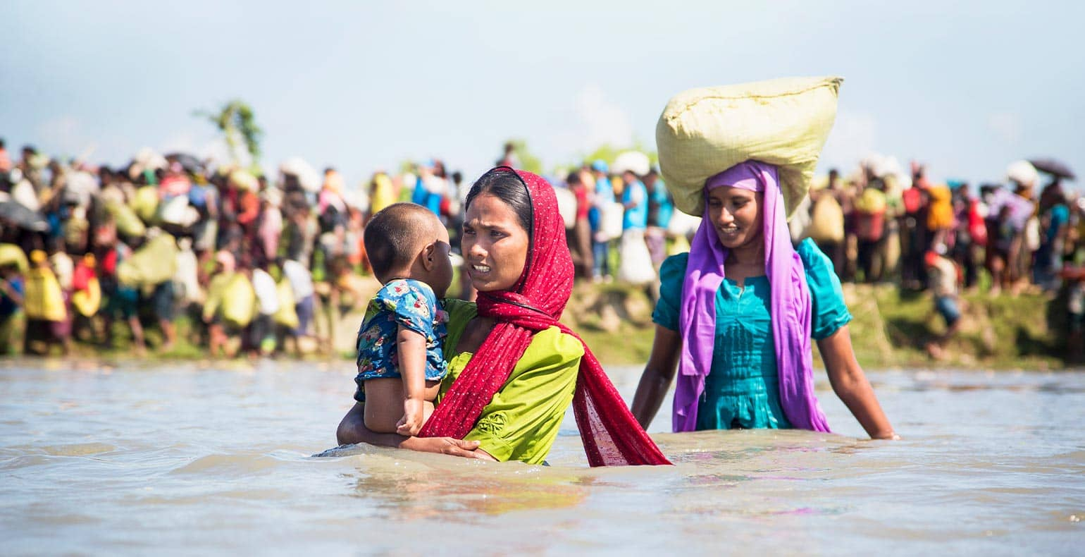 lady refugees fleeing in water